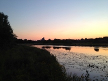 Sunset over the Great Ouse with Ely cathedral in the background