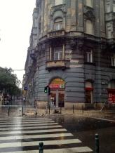 Heavy rain in Budapest destroys building.